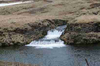Waterfall flowing into Sogið